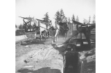 Team of horses moving a water tank during the construction of Fort Lawton, Washington, September...