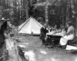 Group of people enjoying a meal at their camp site, Washington, August 4, 1917