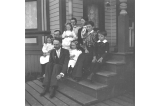 Kiehl, Semple and Drummond family on porch, Seattle, Washington, April 24, 1898