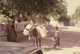 Boy and donkey, both carrying ewers of water