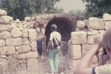 Geoffrey and Anita Jester Landreau going towards the entrance to an underground storage area, with...