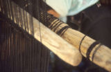 Heddle rod and shed stick on a vertical frame loom