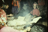 Women cooking bread