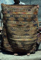 Large striped bag with eye and scorpion motifs, zigzags and s-motifs