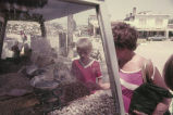 Anita Jester and Geoffrey Landreau buying nuts from a street vendor