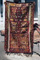 Rug with large hair band and small wolf's mouth motifs