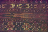 Close-up of a kilim border with s-motifs, crosses and zigzags