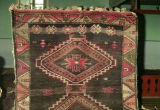 Pile weave rug with stars, lozenges and scorpion motifs