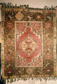 Pile weave rug with medallion and floral patterns