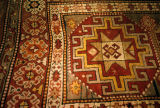 Pile weave rug with Memling gul and stars