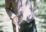 Man holding a heddle rod