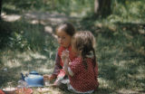 Two girls having a picnic