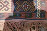 Braided fringe on a kilim with aegricanes and wolf's mouth motifs