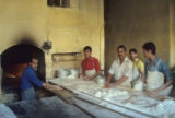 Men making bread in a bakery