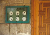 Clocks marking prayer times in a mosque