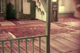 Interior of mosque with minbar and rugs