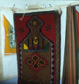 Pile weave prayer rug hanging on a wall