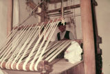 Treadle loom with the cloth beam tension controlled by ropes