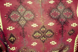 Close up of a kilim with quatrefoils, aegricanes and wolf's mouths