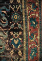 Border of a pile weave rug with carnation motifs
