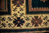 Border of a pile weave rug with crosses rayonnee