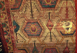 Pile weave rug with hexagons, lozenges, stars and tree of life motifs
