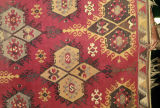 Pile weave rug with quatrefoils, birds and wolf's mouth motifs