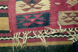 Corner of a kilim with wolf's mouth motifs