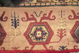 Detail of a pile weave rug with hexagons and tree of life motifs
