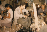 Cobblers working in a small factory
