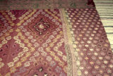 Back of a weft float brocade rug with an allover pattern of lozenges