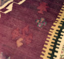 Close up of a kilim with a cross and ashik gul