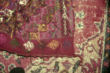 Back of a weft float brocade rug and a pile rug