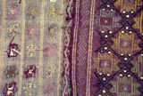 Close up of weft float brocade rug with stars in lozenges