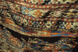 Close up of highly patterned kilim camel bag shown in ICEA1b0122.jpg