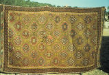 Large weft float brocade rug with allover pattern of stars in lozenges