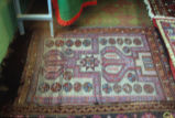 Light colored prayer rug with stars and lozenges