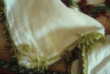 Scarf edged with crochet lace beaded with green beads