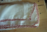 Scarf edged with pink crochet lace with small pearls