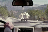 Looking through the windshield at a truck filled with white bags