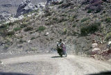 Family on motorcycle on dirt road