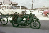 Green motorcycle with weft float brocade saddlebag