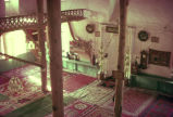 Interior of small mosque with carpeted floor