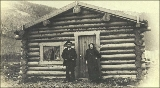 Mr. Antone and woman in front of log cabin, Birch Creek, Yukon territory, ca. 1897.