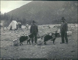 Two Klondikers with dogs packing supplies along the Chilkoot Trail near Dyea, Alaska, 1897.