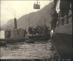 Steamer QUEEN unloading Klondikers and supplies on to a scow in Dyea harbor, Alaska, 1897.