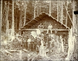 Men outside of log cabin at W.M. Brook's mining camp, probably Alaska, ca. 1896.