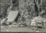 Klondiker's camp with lean-to and supplies at the foot of canyon, Chilkoot Trail, Alaska, 1897.