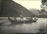 Indians poling canoe up Dyea River, Alaska, 1897.