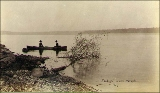 Two women in a rowboat on Lake Washington, probably  in the vicinity of Seattle, Washington, ca....